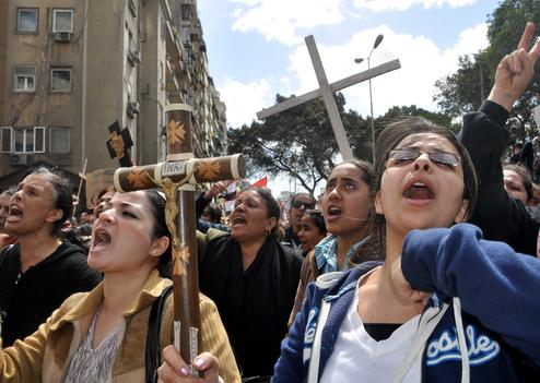 Egyptian Coptic Christians take part in a protest in front of the Information center building in Cairo, Egypt, 09 March 2011. The Coptic Christians were protesting over the burning of a church in Cairo suburbs on 04 March. Photo by Ahmed Asad/Credit:AHMED ASAD/APA IMAGES/SIPA/1103091853